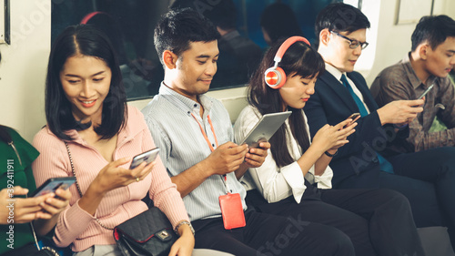 Papel de parede Young people using mobile phone in public underground train