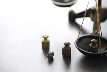 Tiny Weights On Vintage Balance Scales. Detail Of Ancient Old Scale, Vintage Old Brass Weight Scale.