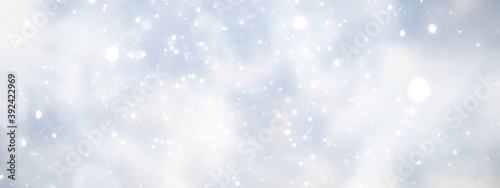 Obraz na plátně blue snowfall bokeh background, abstract snowflake background on blurred abstrac