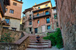Sitting on some stairs in the medieval town of Albarracin, Teruel, Spain