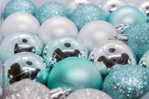 Leinwand Poster Christmas and Holiday decore baubles ranging in colors from blue, silver, red, g