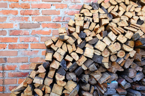 Papel de parede Brick wall with Wooden logs,boards, firewood