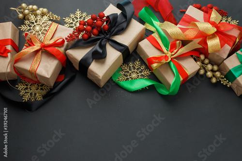 Set of gift boxes, christmas decorations on dark background, stylish luxury happ Fototapet