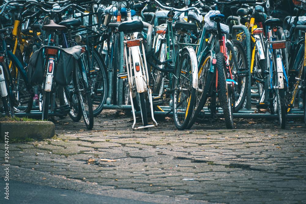 Fototapeta Closeup shot of bicycles parked outdoors