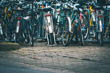 Closeup Shot Of Bicycles Parked Outdoors