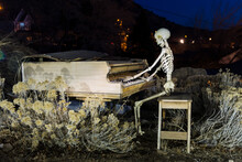 Skeleton Plays Piano On A Cold Spooky Night In A Desert Ghost Town