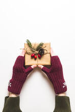Christmas Composition. Female Hands Keeping Christmas Gifts Isolated On White. Flat Lay, Top View, Copy Space.