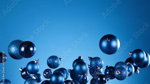 Flying christmas balls on coloured background Fotobehang