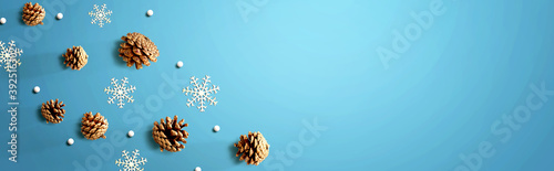 Fotografering Christmas pine cones with snow flakes - flat lay