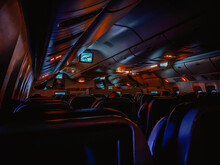 Dark Aircraft Cabin With Red And Blue Lighting
