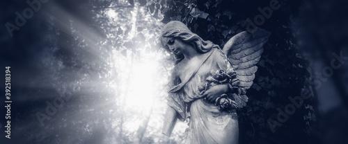 Sad Angel of death.. Ancient statue. Horizontal image. Canvas