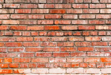 Grunge Red Brick Wall Background. Aged Wall Texture. Weathered Brickwork. Grungy Stonewall Background. Rough Texture Block Wall.