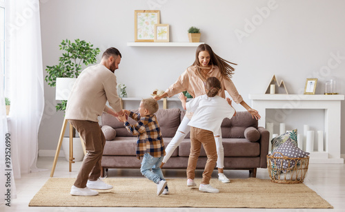 Fototapeta happy family mother father and children dancing at home  . obraz