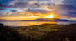Panoramic Aerial Sunset View of an Island In the Pacific Northwest. Dramatic clouds highlight this drone shot of surrounding islands in the Salish Sea area of western Washington state. Lummi Island.