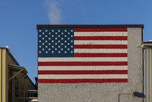 BARRE, VERMONT, USA - FEBRUARY, 20, 2020: Flag Of The United States Of America Painted Onto A Wall