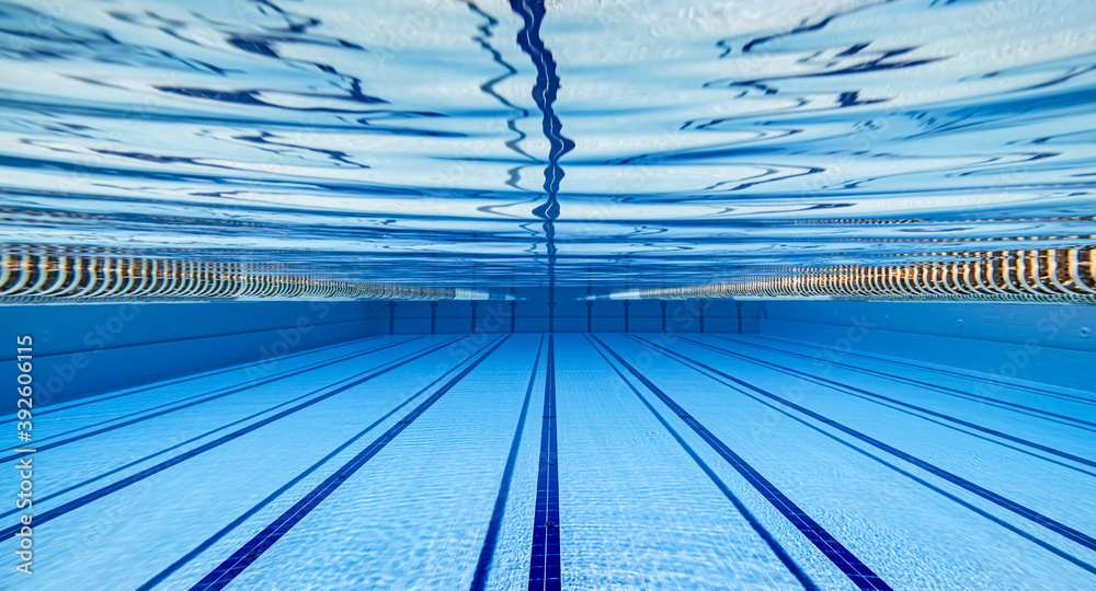 Fototapeta Olympic Swimming pool under water background.
