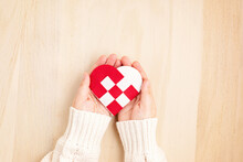 Giving Tuesday Concept With Woman Hands Holding Red And White Heart, Charity Day Concept