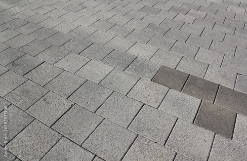 Slika na platnu Grey brick stone street road. Light sidewalk, pavement texture