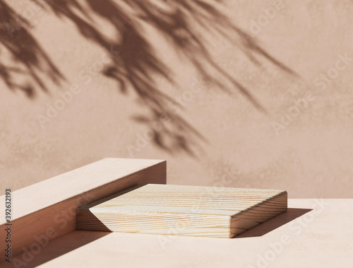 Obraz 3D  wooden podium display with leaf shadow. Copy space beige background. Cosmetics or beauty product promotion mockup.  Natural stone step pedestal. Trendy minimalist banner, 3D render illustration. - fototapety do salonu