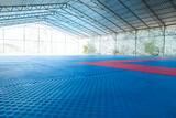 Empty oriental martial arts pavilion with tatami