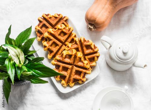 Pumpkin oatmeal wholemeal waffle on a light background, top view Fotobehang