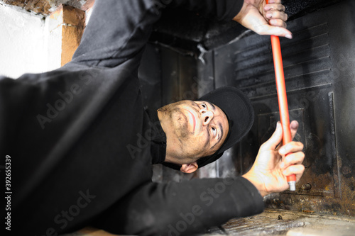 Young chimney sweep at work Fototapet