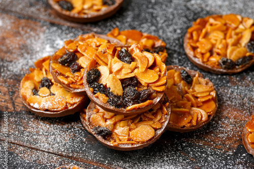 Tablou Canvas Christmas Chocolate Florentines cookies with almond and raisins with decoration,