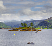 The Bay Near The Village Of Plockton. Plockton Is A Picturesque Highland Village That Sits On A Sheltered Bay With Stunning Views Overlooking Loch Carron Of Scotland In The County Of Ross And Cromarty