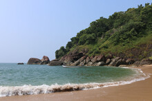 Rocky Green Island Of Butterfl...