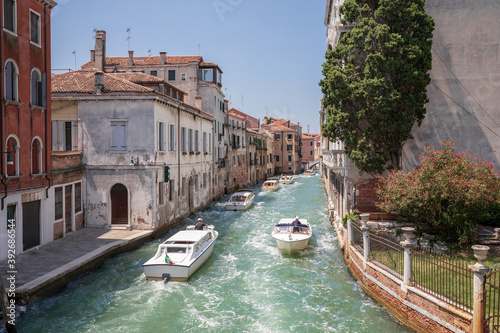 Fotografie, Tablou Panoramic view of Venice narrow canal with historical buildings and boats