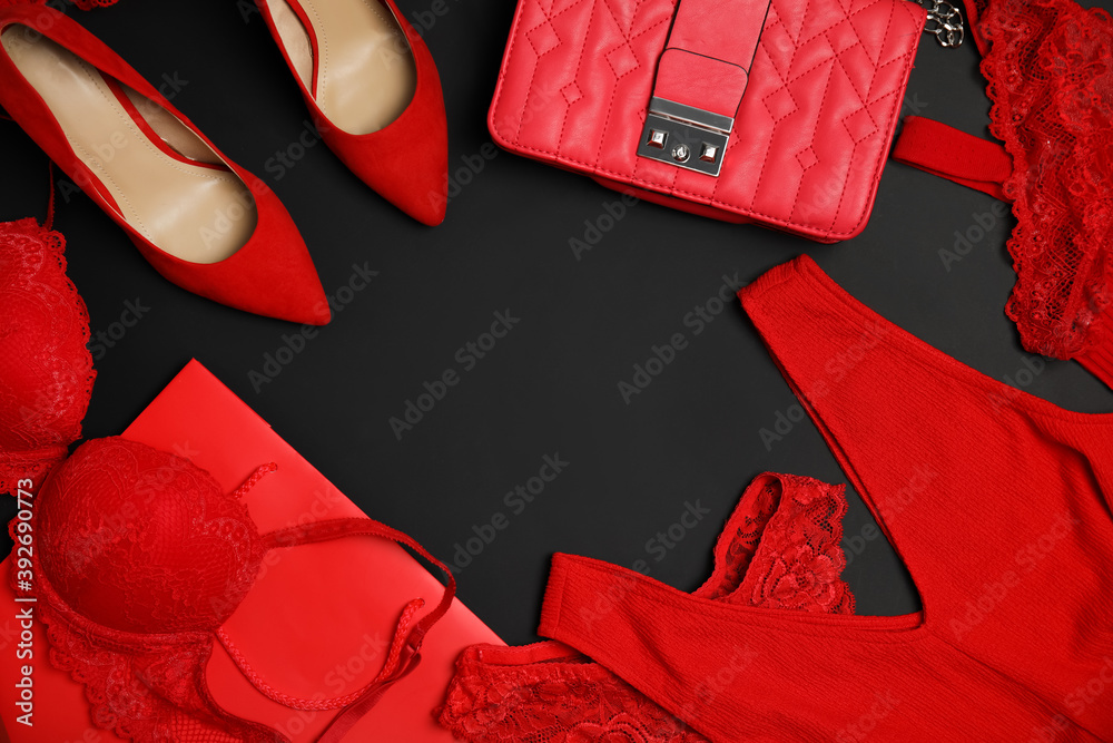 Fototapeta Women's underwear, shoes and accessories on black background, flat lay. Space for text