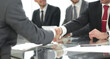 handshake business people sitting at the office Desk