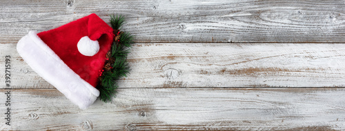 Christmas or New Year holiday background with Santa cap and evergreen tips
