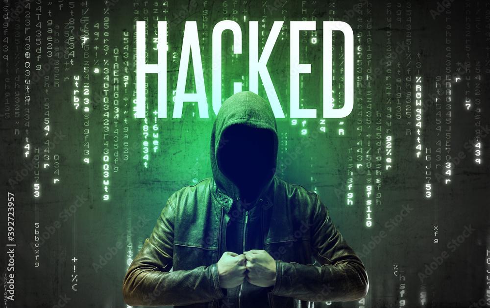 Fototapeta Faceless hacker with HACKED inscription, hacking concept