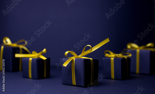 Navy blue gift with gold ribbons Fotobehang