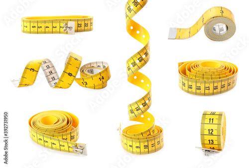 Fotografie, Obraz Set of yellow measuring tapes on white background