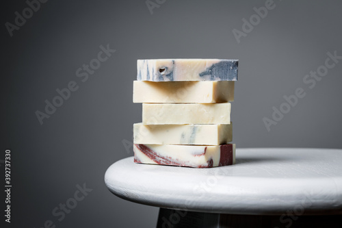 Fototapeta Natural handmade soap bars with different ingredients on a white wooden background. obraz