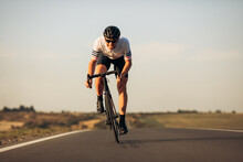 Happy Road Cyclist In Protective Helmet Training Outdoors