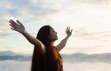 Worship God Concept: Happy Girl On Blurred Mountain Sunrise Background. Ai Yerweng, Bethong, Yala, Thailand, Asia