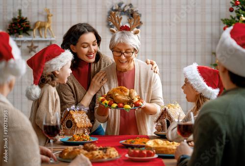 Fototapeta family celebrating Christmas