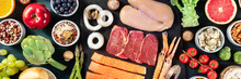 Food Panorama, Top Shot. Beef, Chicken, Salmon, Rice, Cheese, Fruit And Vegetables, An Assortment Of Fresh Products On A Dark Blue Wooden Background