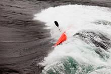 Kayaker In White Water Paddling Breaking Waves