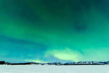 Northern Lights Over Moon Lit Frozen Lake Laberge