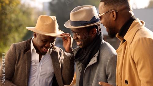 Obraz African friends talks in a city street - fototapety do salonu