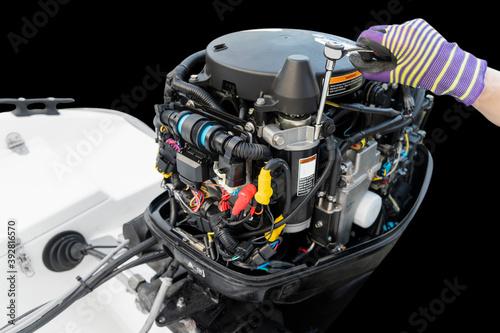 Fotografie, Obraz Repairing  outboard marine engine