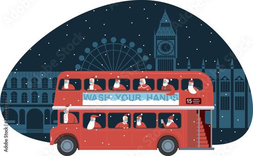Fototapeta Traditional British red double decker bus full of Santas over Christmas London background