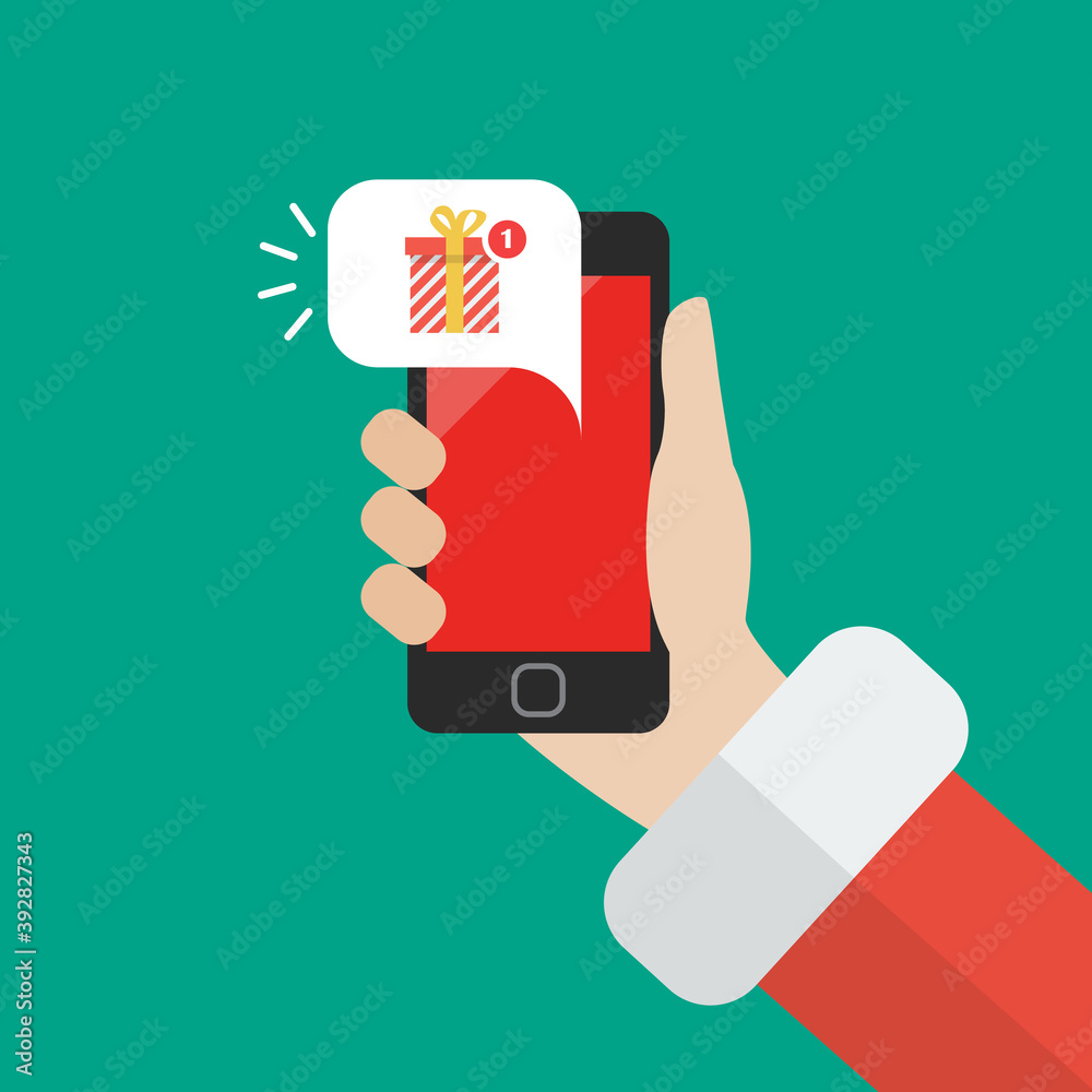 Fototapeta Santa Claus holding smartphone with gift box notification