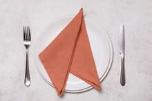 Rolled Up Orange Napkin In A C...