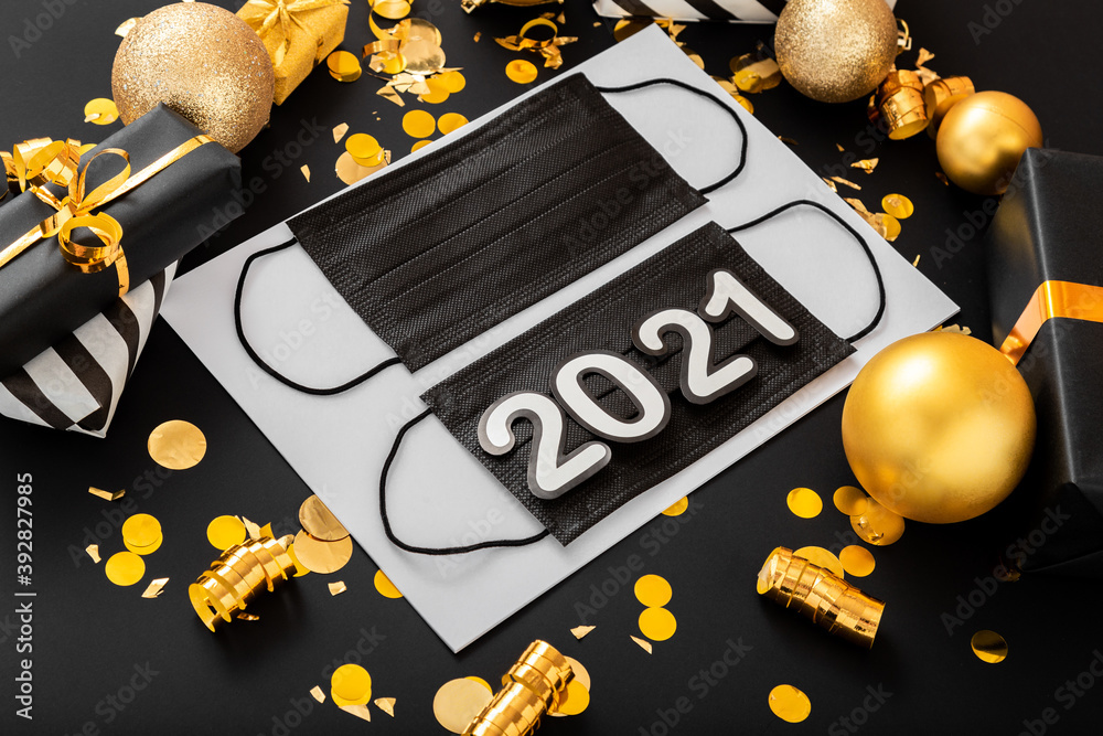 Fototapeta 2021 text lettering on Black medical face mask with gold Christmas festive decor. Protective face surgical masks. Celebrating New Year in quarantine covid 19 Coronavirus. Lockdown