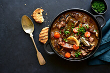 Beef Bourguignon - Meat Stew With Vegetables And Mushrooms With Red Wine, Traditinal Dish Of French Cuisine. Top View With Copy Space.